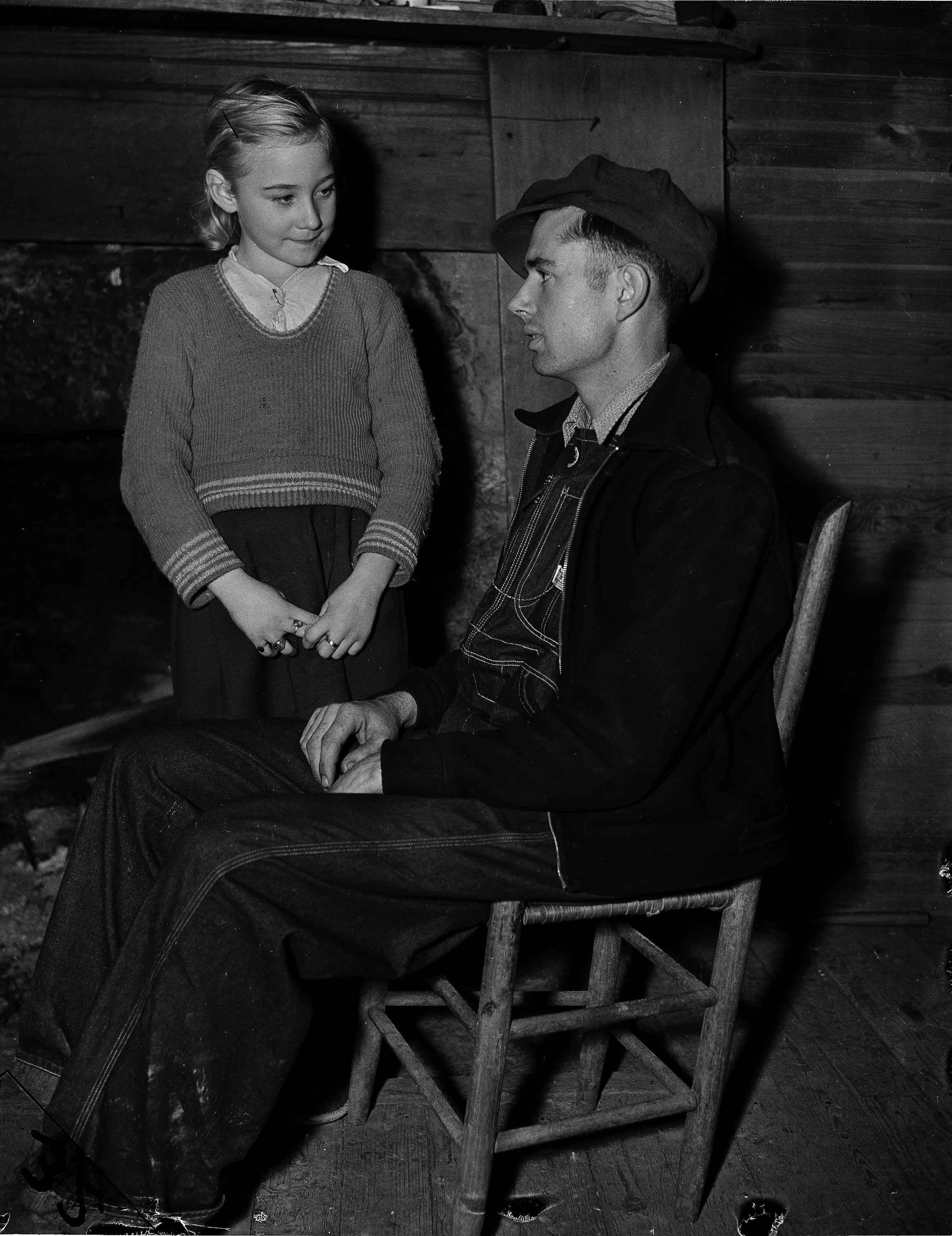 "Nine-year-old Eunice Winstead Johns and her six-foot mountaineer husband, Charlie Johns, 22, are shown at their home in Sneedville, Tenn., Feb. 2, 1937. Gov. Gordon Browning of Tennessee called the marriage, which provoked widespread discussion, ""Nothing Short of Tragedy."" (AP Photo)"
