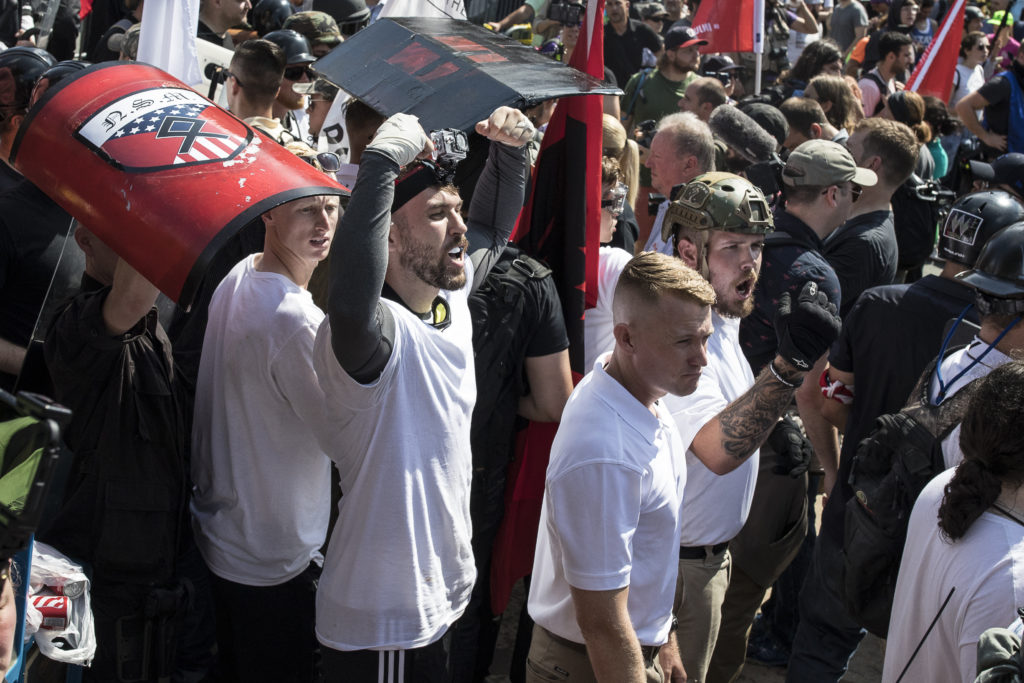 Michael Miselis (with arms raised) was front and center during the violence in Charlottesville, Va. last summer.