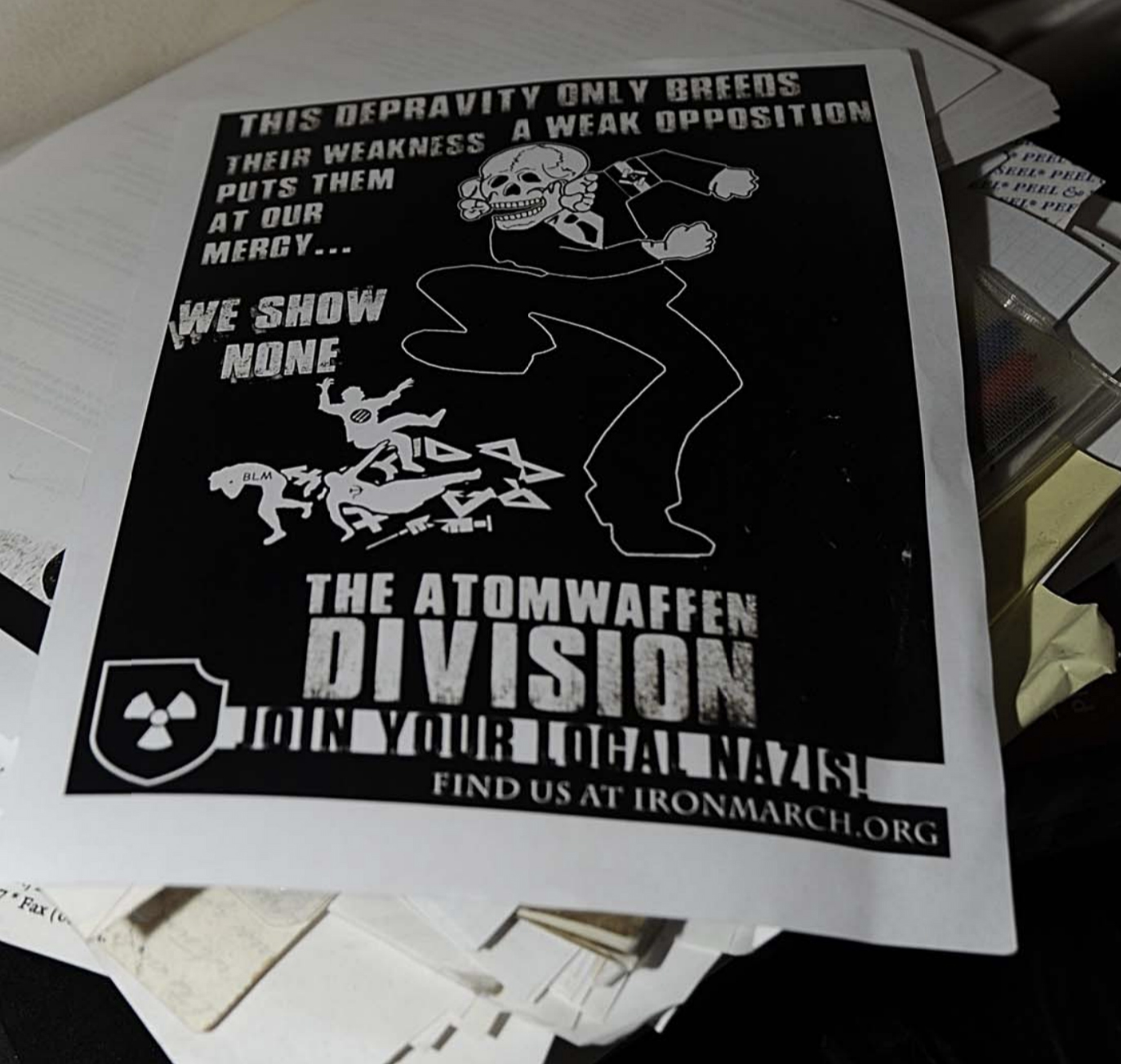 A flyer from Atomwaffen Division that was found during a search of Jeffrey and Edward Clark's house.