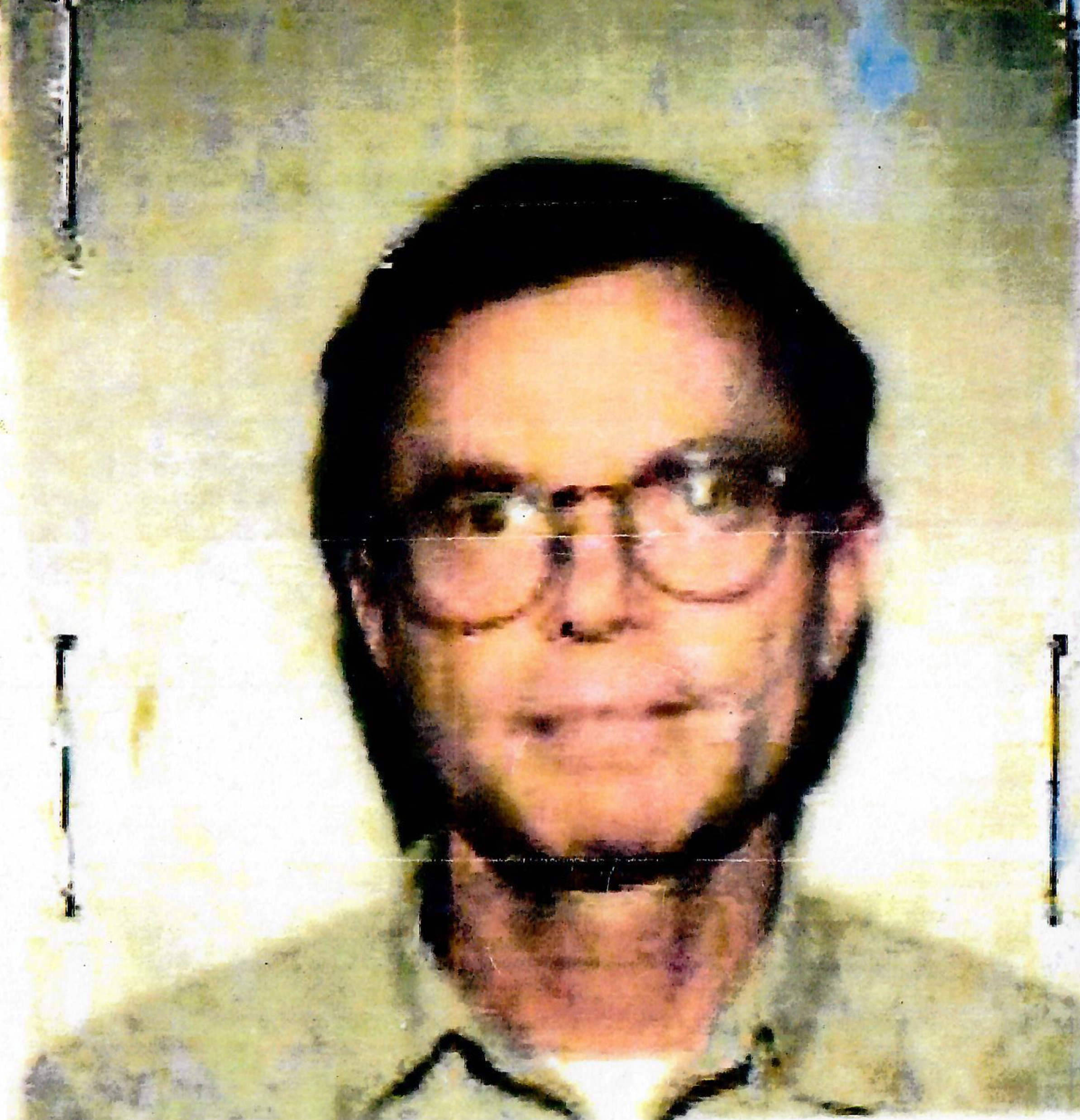 Dr. Stanley Patrick Weber in a 1990s passport photo.