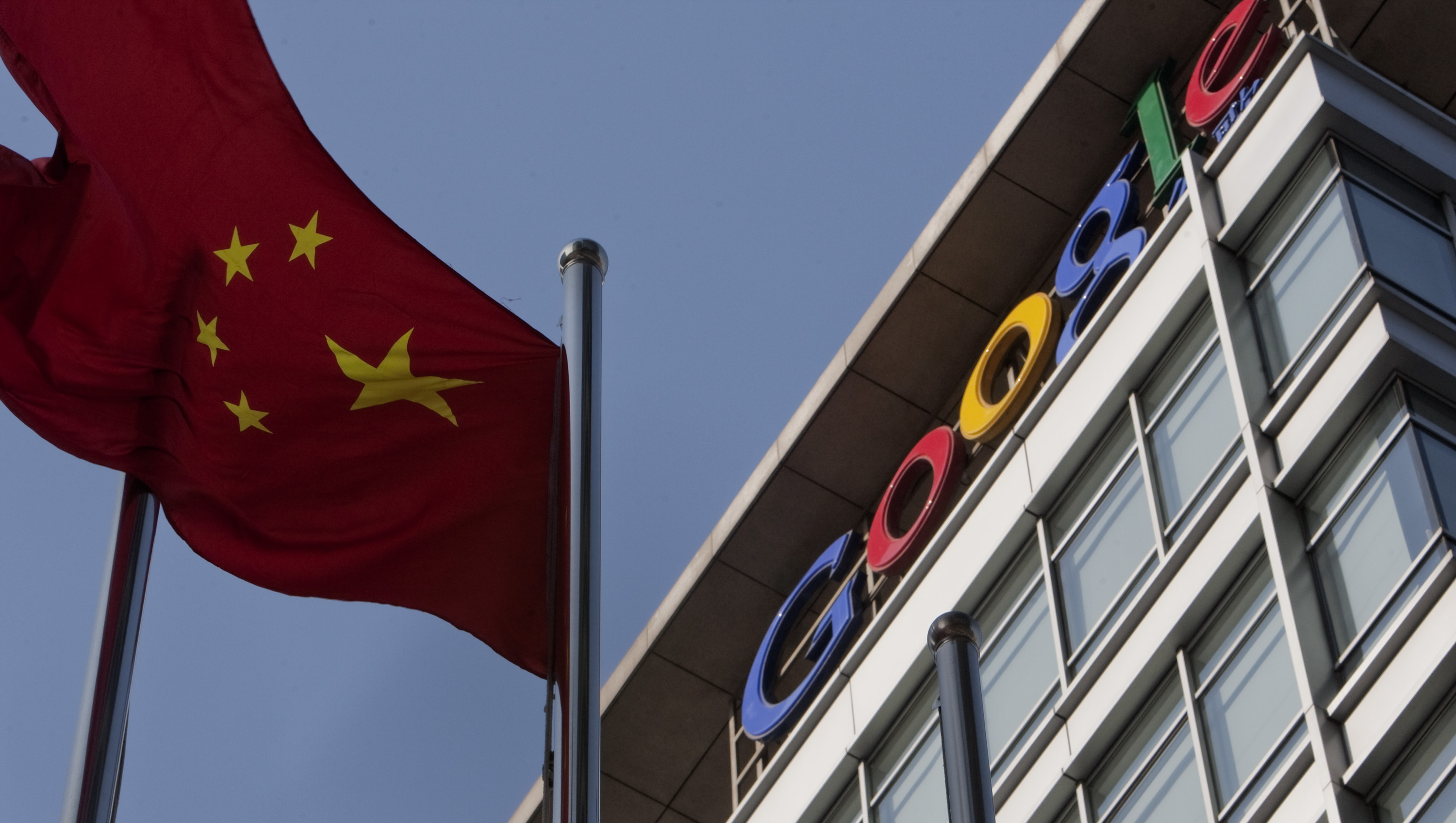 The Chinese flag flies outside the Google Inc. office in Beijing, China, on Thursday, Jan. 14, 2010.