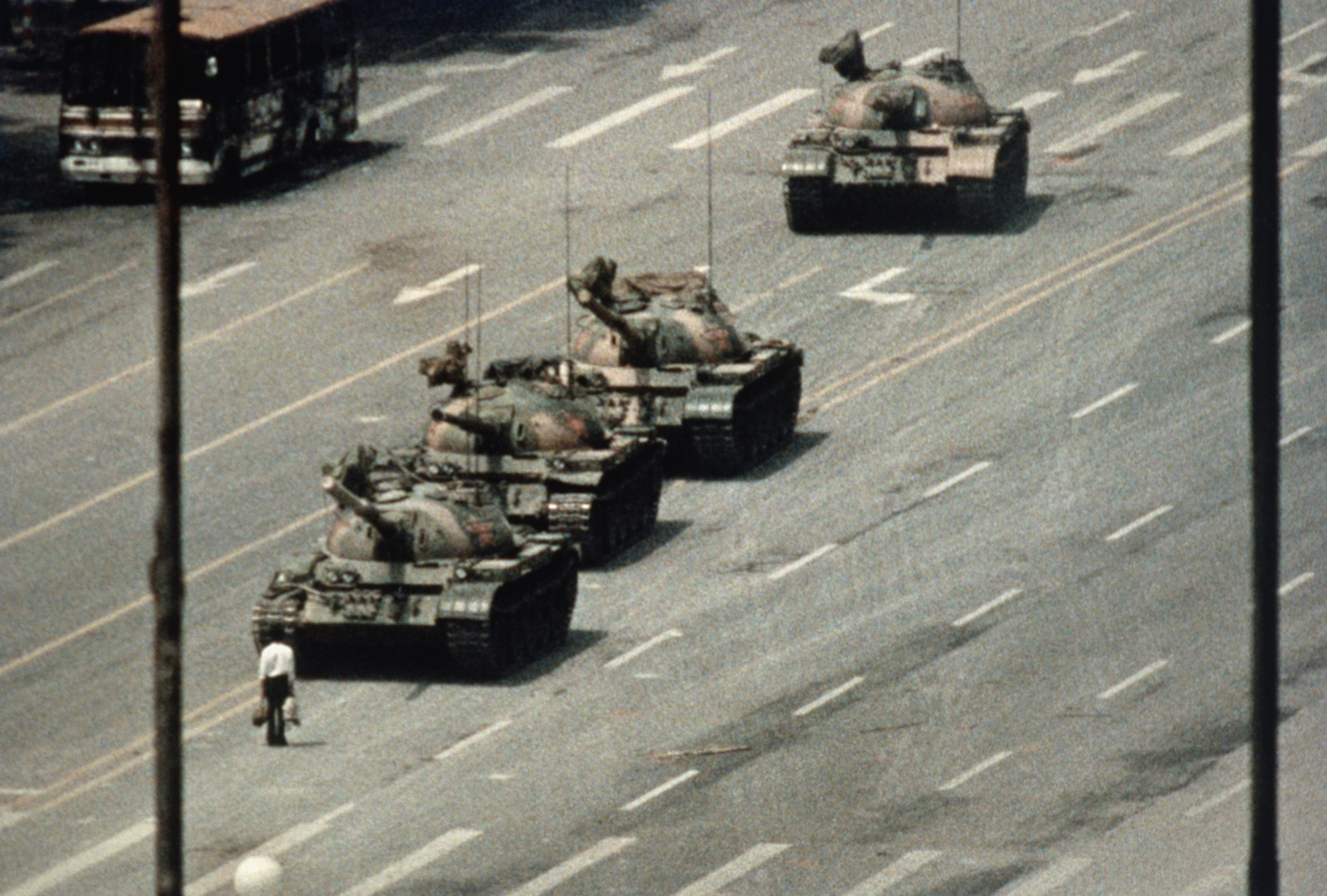 A Beijing demonstrator blocks the path of a tank convoy along the Avenue of Eternal Peace near Tiananmen Square. For weeks, people have been protesting for freedom of speech and of press from the Chinese government.