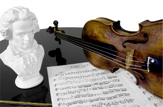 Beethoven bust, a violin, and sheet music atop a piano.
