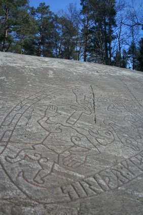 carved figure with runes