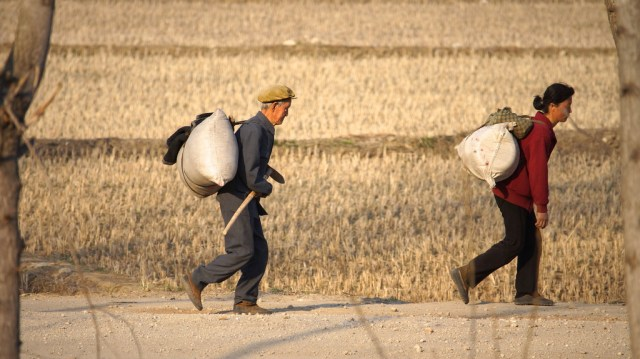 Farmers carrying supplies in North Korea
