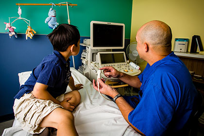 doctor showing child medical equipment
