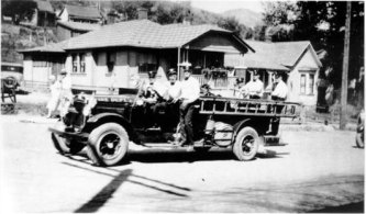 date unknown, William Berry driving fire truck decorated with American flags (probably 4th of July or Labor Day)