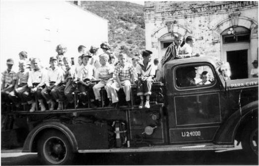 ca.1956, kids riding fire truck on Labor Day, 1956, William Berry driving, his grandson Ted Larremore is one of the kids