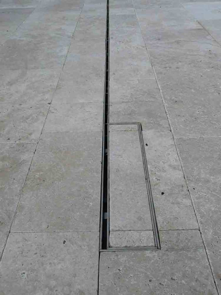 Slot drain in Travertine paving