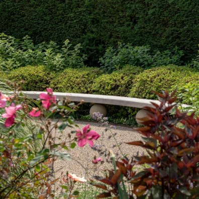 Bespoke bench surrounded by dwarf Rhododendron , Exbury Centenary Garden built by PC Landscapes