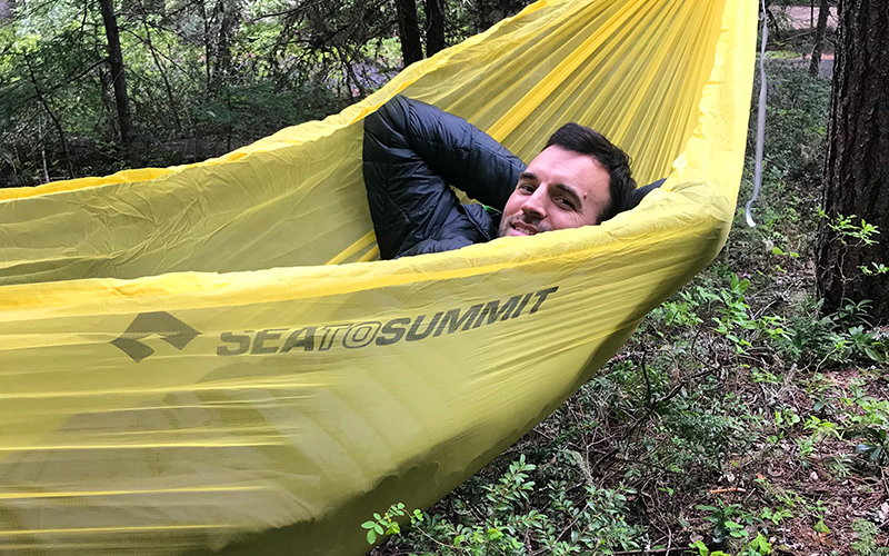 hiker in sea to summit hammock