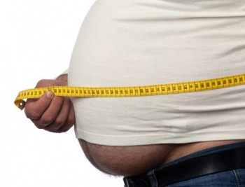 Overweight at 50 Tied to Earlier Alzheimer's