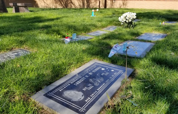 The gravesite of Christy McKendall, who was killed when she was 16 in 2002, is shown here at Montecito Memorial Park in Colton. (Photo by Beatriz E. Valenzuela/SCNG)