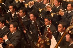 An El Sistema orchestra performing, all musicians coming from low-income and high-risk backgrounds