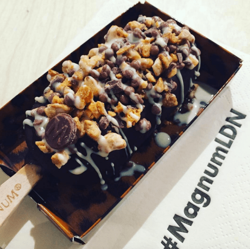 My Magnum - peanut butter dipped, topped with cinnamon and vanilla almonds, caramel chocolate balls, honeycomb, and drizzled in white chocolate. *heart eyes emoji*