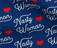 """fabric with the text """"Nasty Woman"""" in white with red hearts on a blue background"""