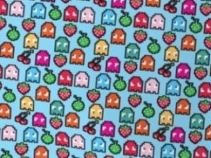 fabric with colorful characters from Pacman on a light blue background