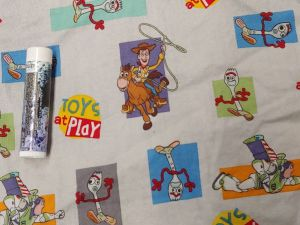characters from Toy Story movie on a grey background