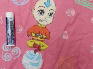 Aang, the Avatar and last Airbender on a ball of air, with symbols from each kingdom on a dark pink background