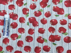 apples on a white wood background