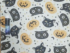black cats, owls, and jack o'lanterns on a white background