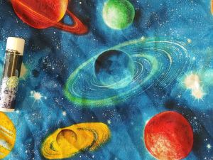"""planets and stars on a blue """"outer space"""" background"""