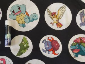 Pokemon creatures in white circles on a black background