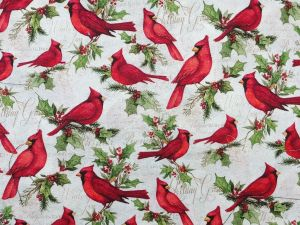 white background with a red cardinal sitting on holly branches with green leaves and red berries