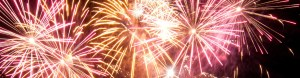 Close up of pink and gold fireworks in the night sky
