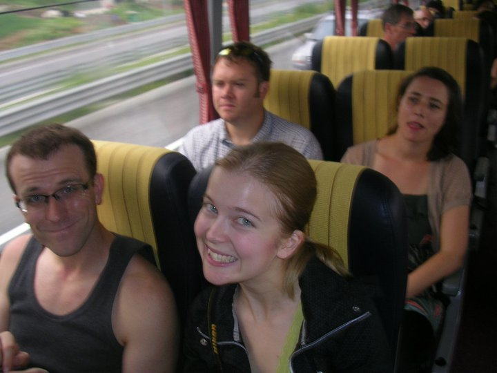 An image of the author on a bus. She is surrounded by other members of the Seoul Flyers running club, and smiling at the camera.