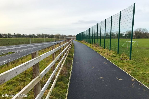 A pleasant new tarmac path above the road now opens out for a good distance.