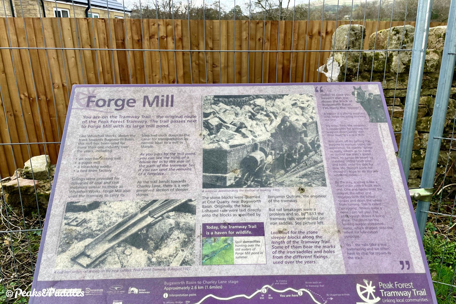 An interpretation board for Forge Mill remains where the mill has been replaced by housing.