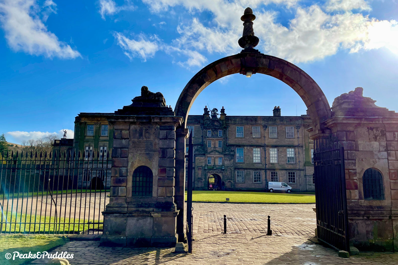 The entrance gate and frontage to Lyme Hall is less recognisable than the Italianate facade on the garden side.