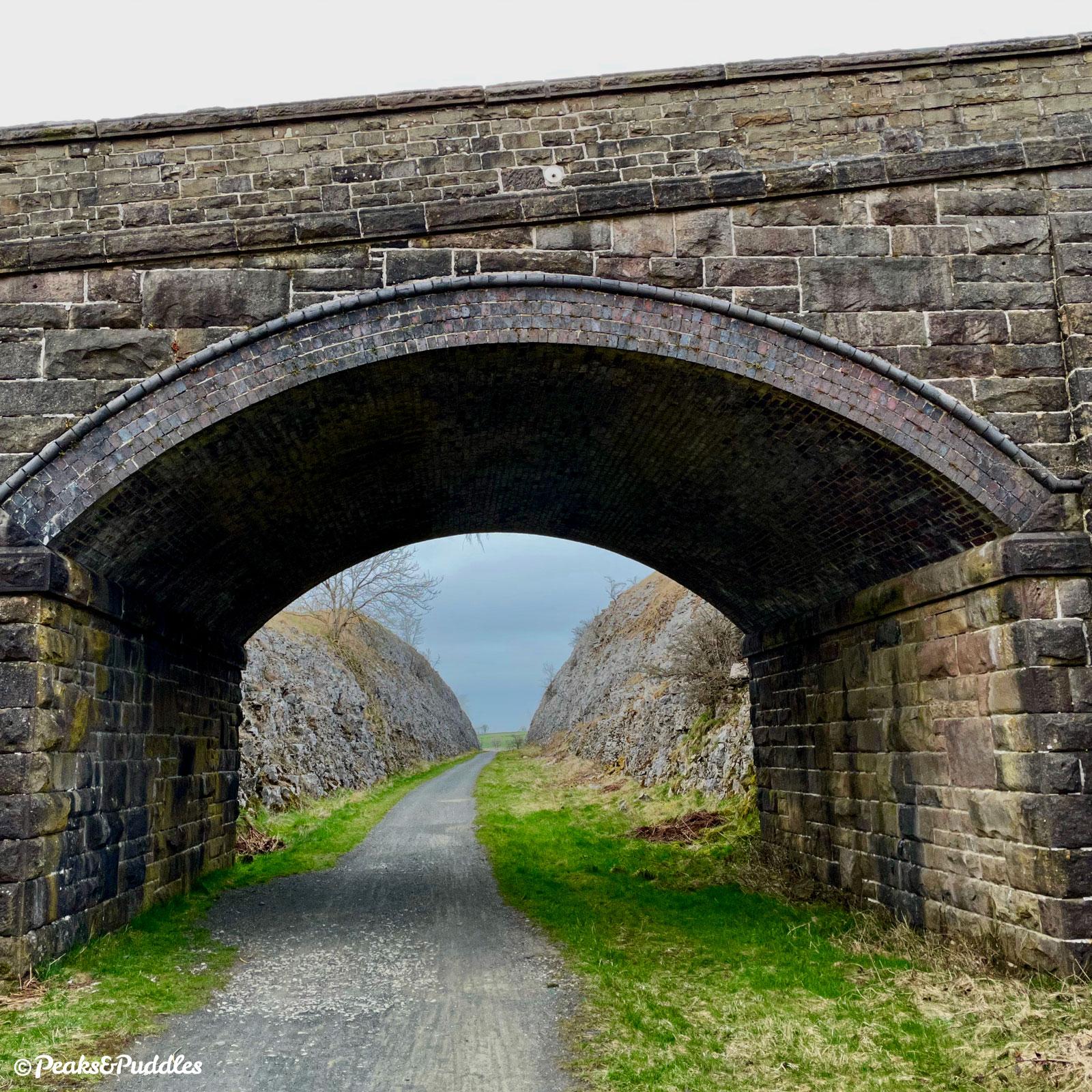 Returning to Parsley Hay, the accommodation bridge frames the railway's deep rock cutting.