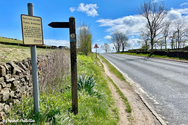 Where the bridleway joins the A624, a well-worn verge offers an easier route up to the right turn for Peep-O-Day — it wouldn't take much for Derbyshire County Council to make this an official link.