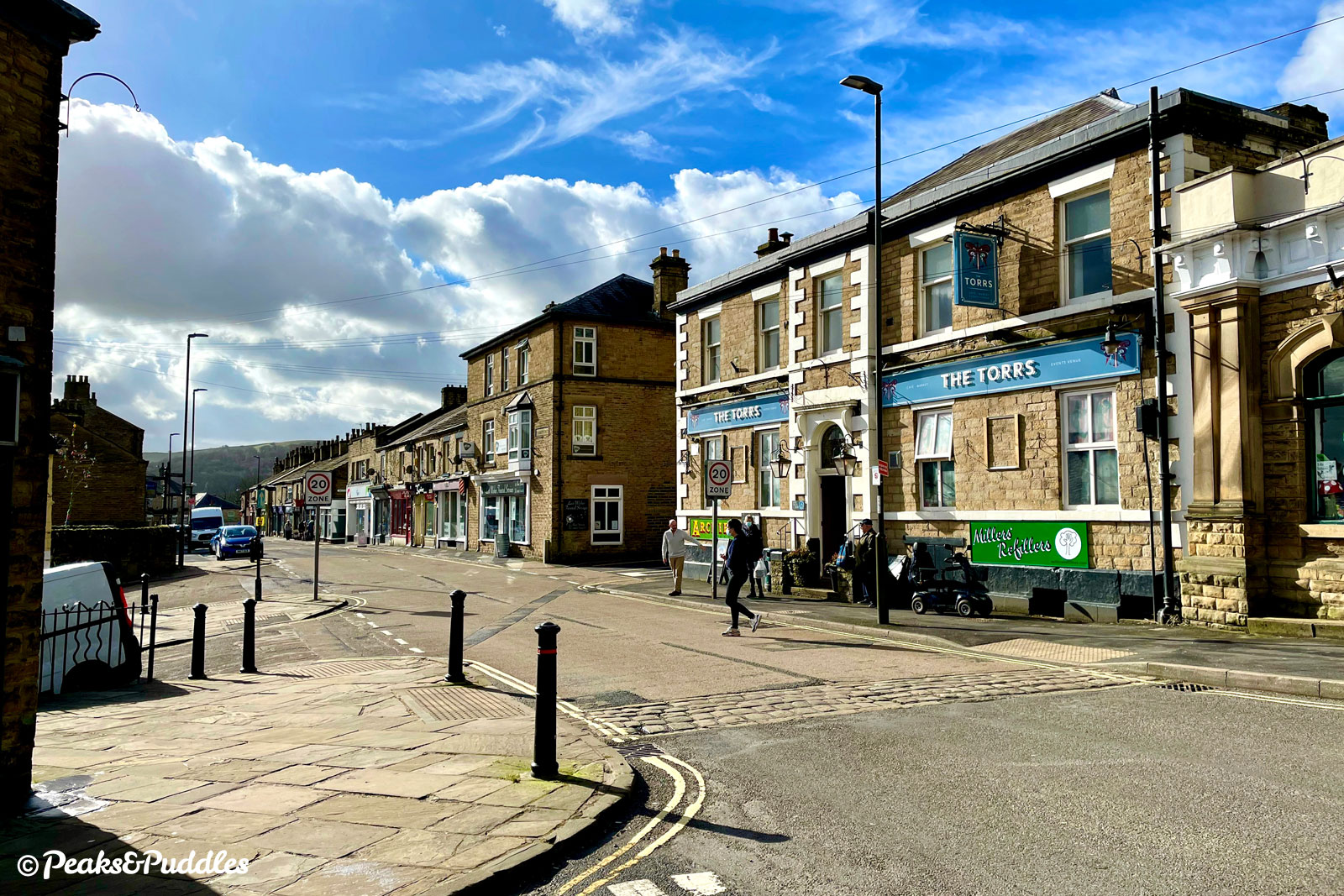 Market Street in the centre of New Mills has pubs, cafes, unique independents, charity shops and a mini supermarket.