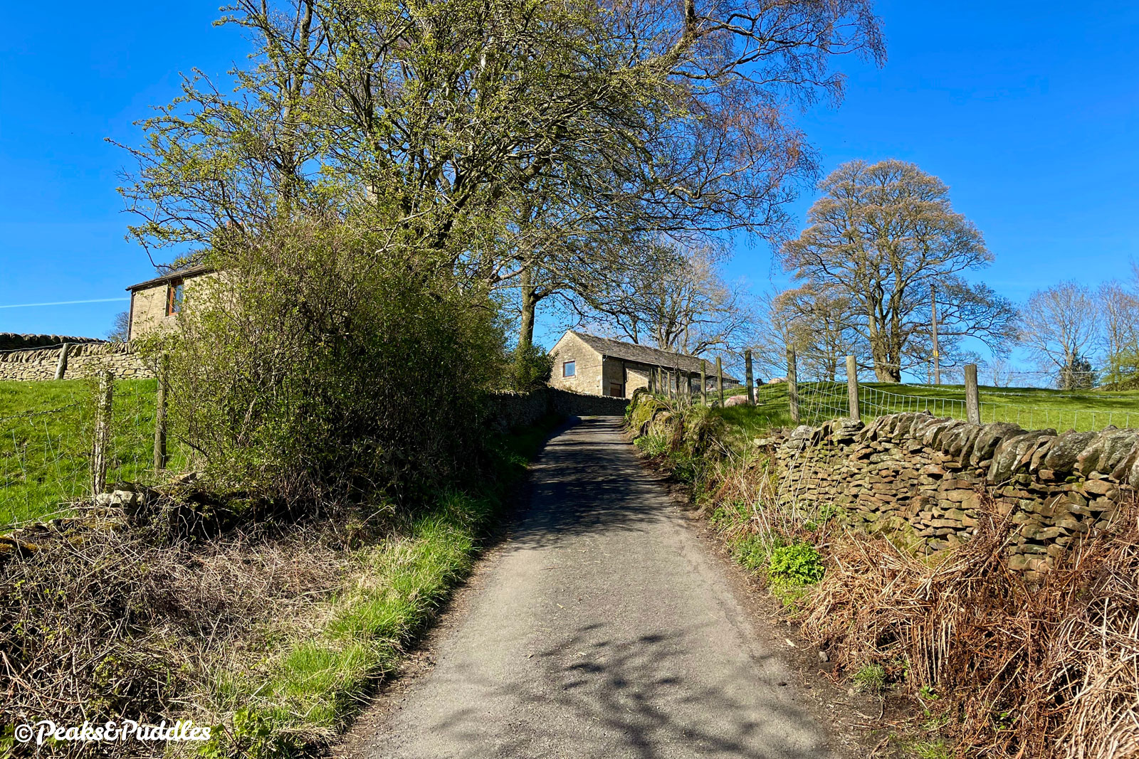 A sharp climb leads up to Roych Farm, which enjoys rural, isolated views of The Roych.