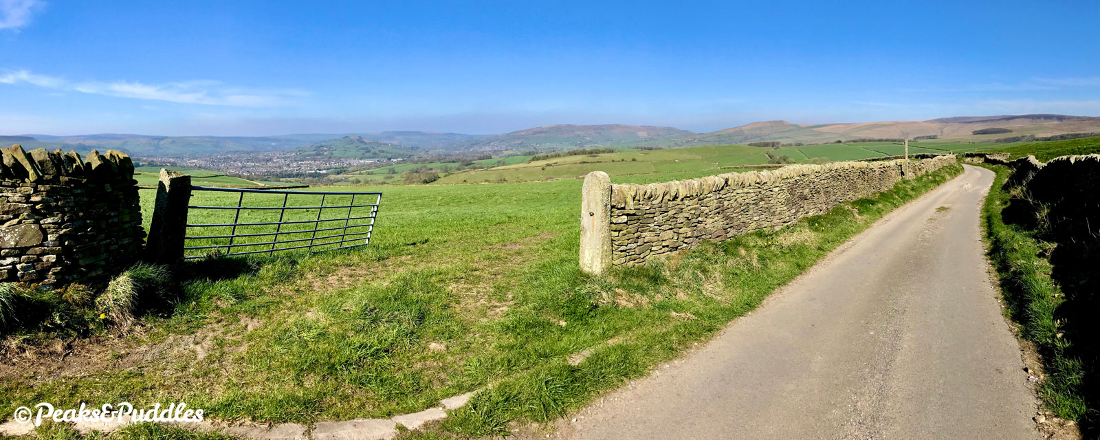 A panorama of the spectacular view looking back from the top of the Slackhall-Sparrowpit climbs, with far-reaching views of Chinley Churn, South Head and Rushup Edge.