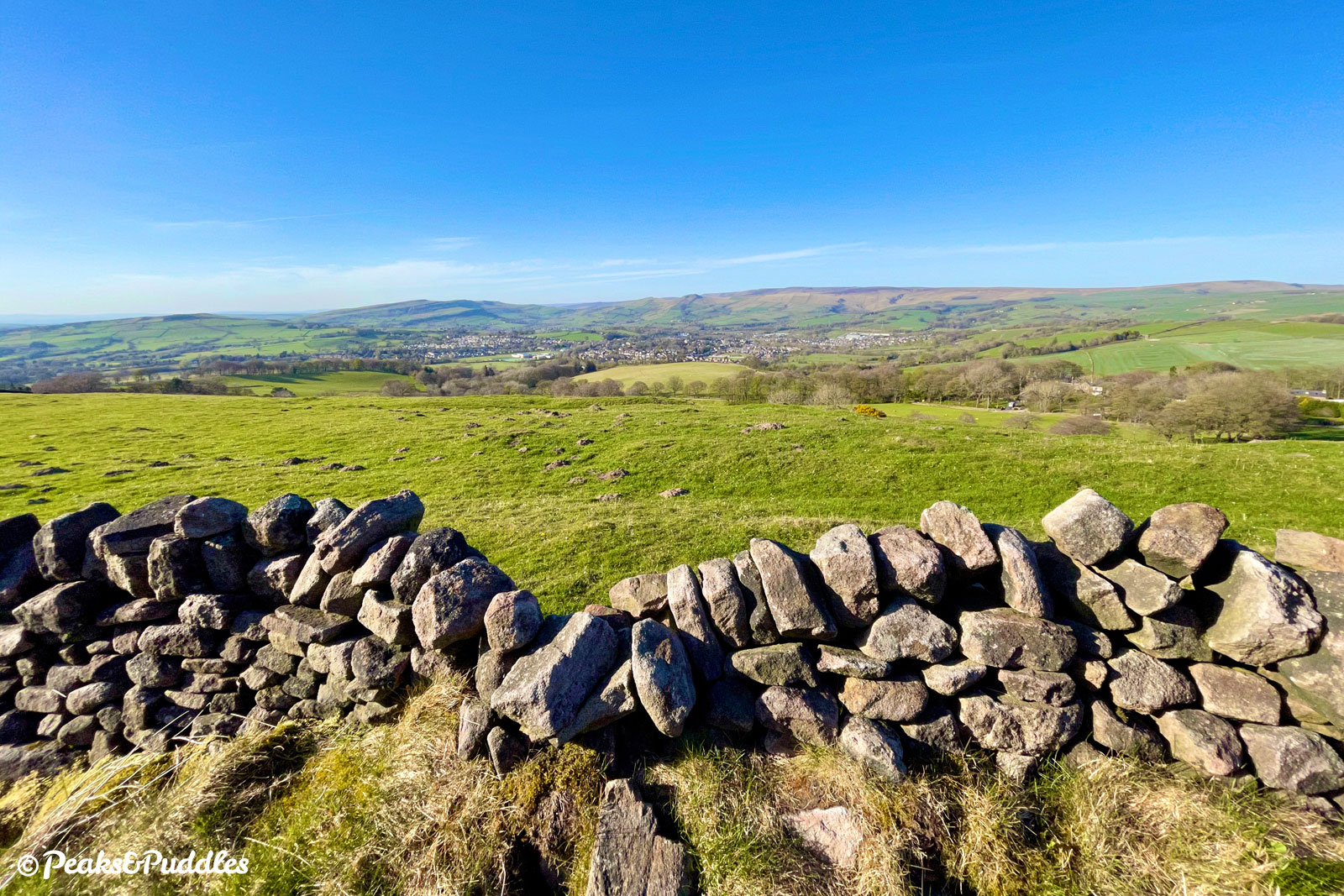 Cowlow Lane offers a spectacular panorama over Chapel-en-le-Frith and beyond to Chinley Churn and the southern side of Kinder Scout.