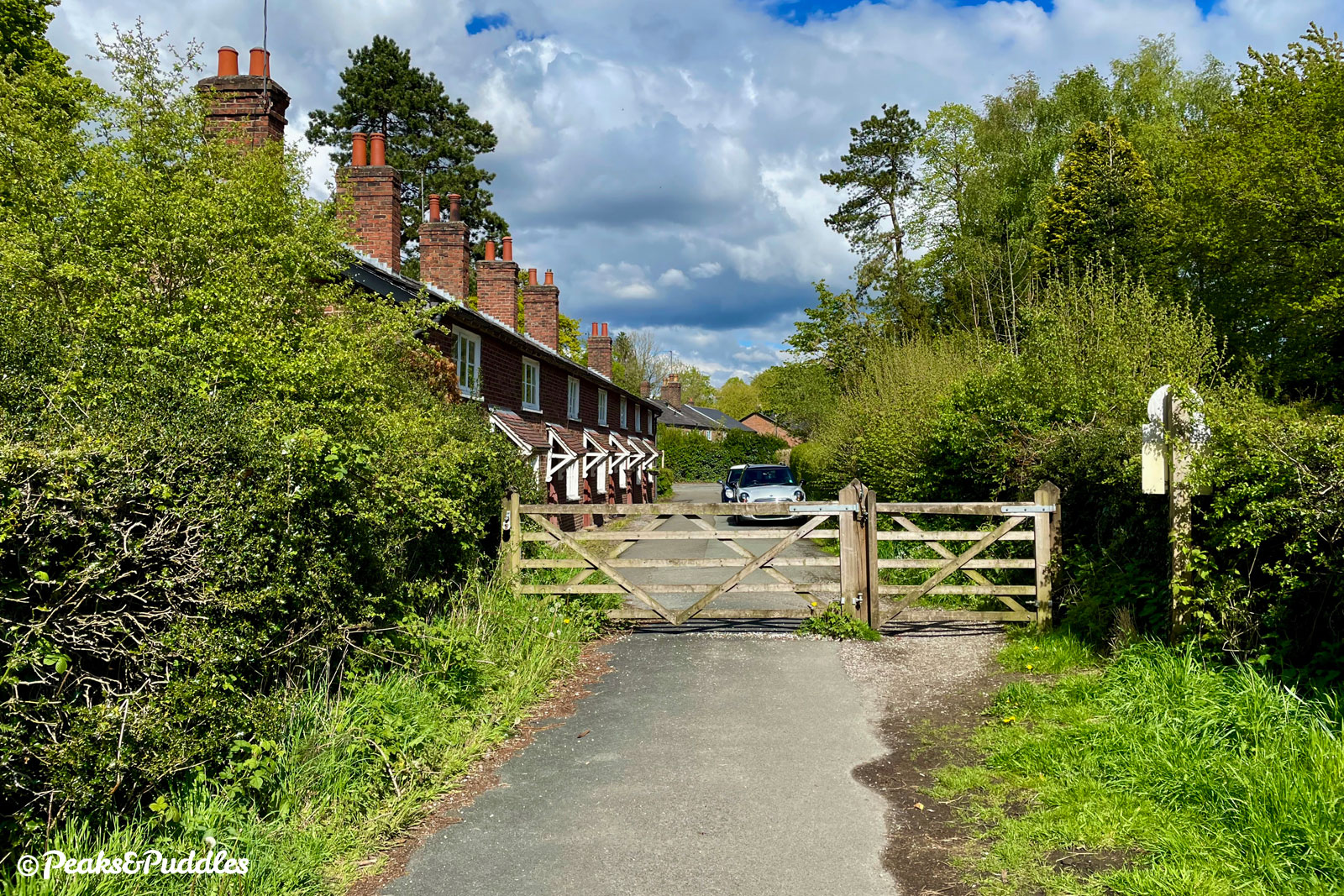 Leaving the Quarry Bank estate and approaching the main Style Road at a row of squat redbrick cottages.