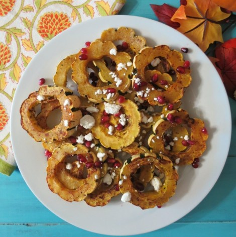Baked Delicata Squash with Pomegrante and Goat Cheese