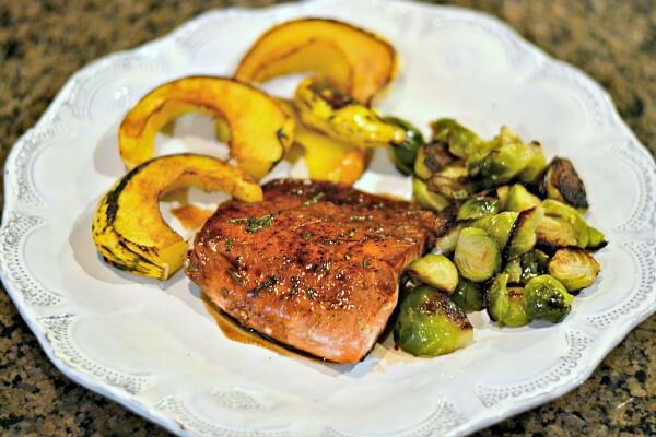Whole30 compliant balasamic salmon with roasted brussels sprouts and acorn squash.