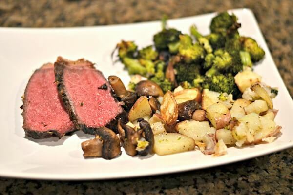 Whole30 compliant sirloin tip roast with roasted mushrooms, potatoes and broccoli.