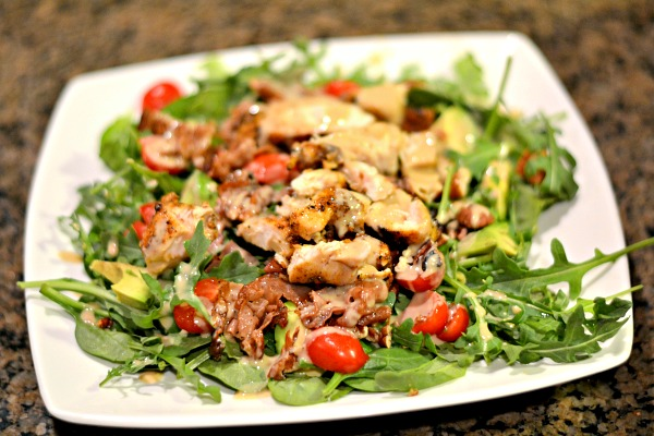 Salad with arugula, spinach, tomatoes, avocado, toasted pecans, sauteed prosciutto and sauteed chicken tenders with a homemade tahini dressing.