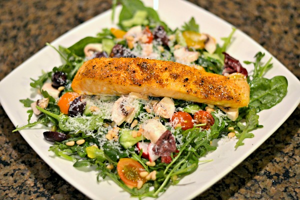Salad topped with salmon