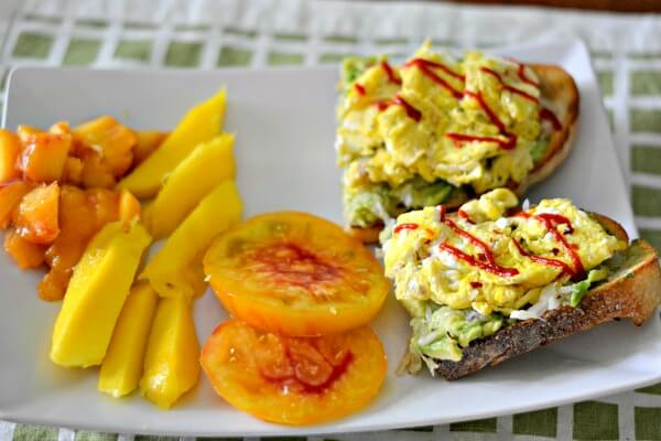 Sourdough toast with mashed avocado, sauerkraut and scrambled eggs