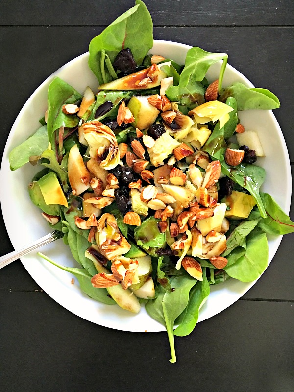 Salad with power greens mix, avocado, dried cherries, toasted almonds, pears and artichokes