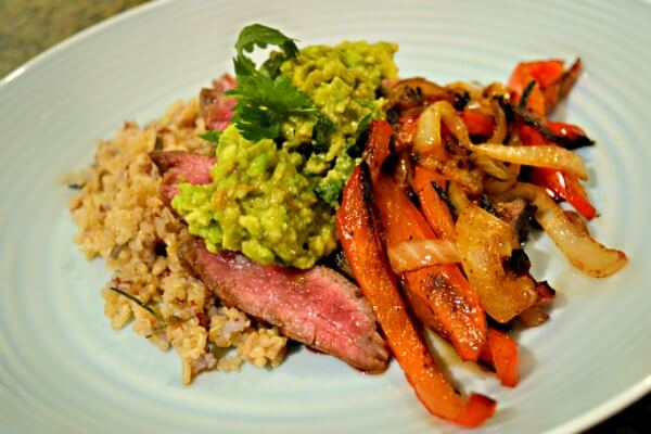 Marinated Flank Steak with peppers, onions and guacamole