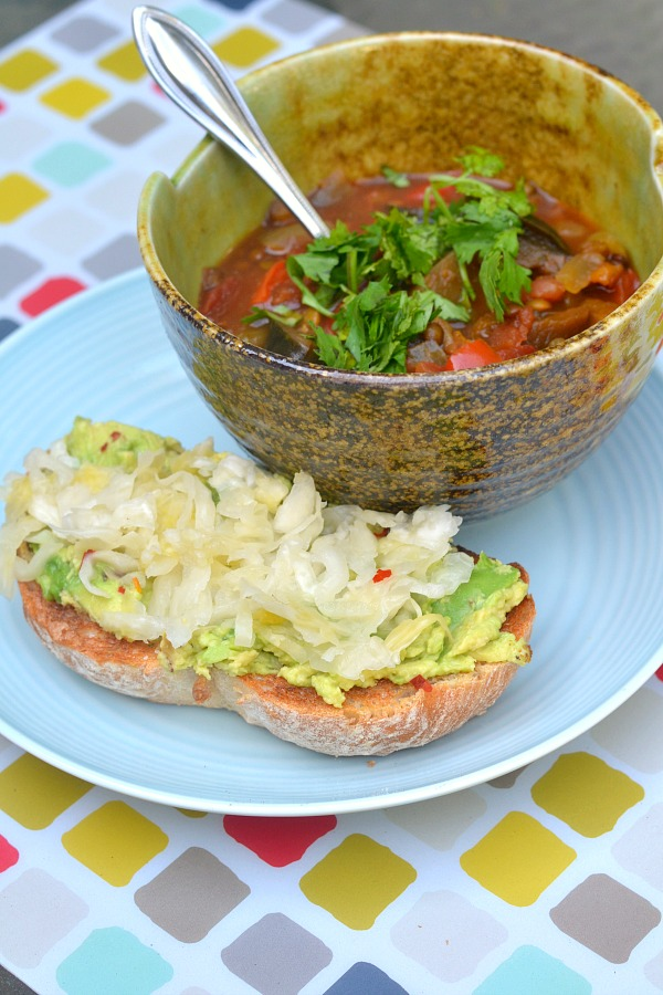 Armenian Lentil Soup with a piece of sourdough toast with mashed avocado and sauerkraut.