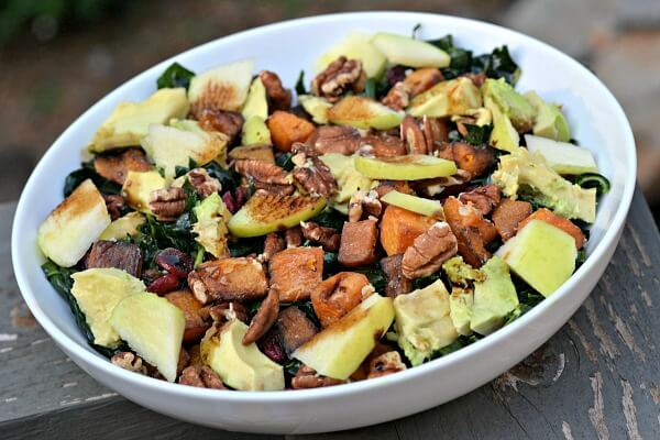 massaged kale salad with roasted butternut squash, toasted pecans, dried cranberries, apples and avocado with a drizzle of balsamic